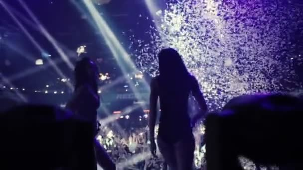 MOSCOW, RUSSIA - AUGUST 15, 2015: 20 years of Radio Record. Confetti sequins falling on go go girls dancers