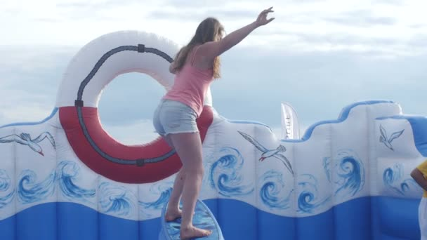 ST  PETERSBURG, RUSSIA - JULY 18, 2015: VK FEST  Girl on surf simulator on  beach