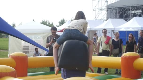 ST. PETERSBURG, RUSSIA - JULY 18, 2015: VK FEST. Riding a mechanical bull. Slow motion