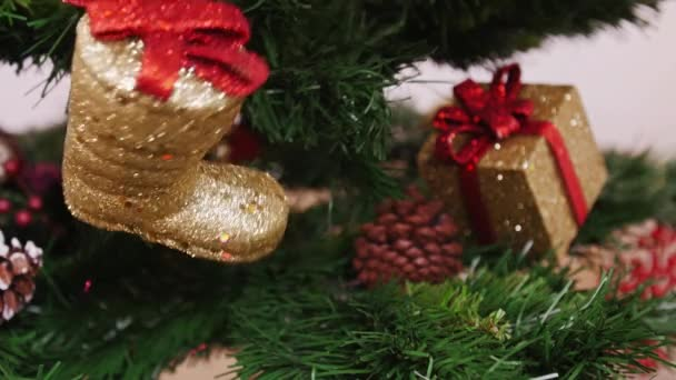 Decoration of Christmas tree golden boot