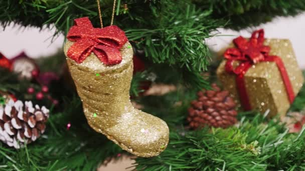 Decoration of Christmas tree golden boot. Pan