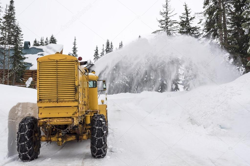 Yellow Snow Removal Machine Clearing Mountain Road