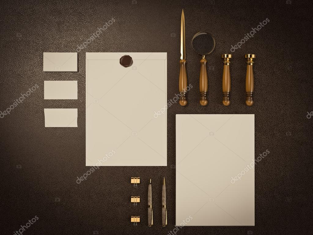 Set of identity elements on brown leather background