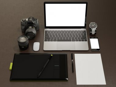 Designer accessories and gadgets on brown leather  background