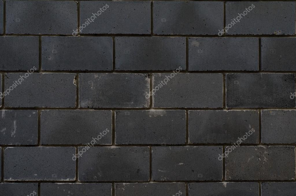 Sfondo di piastrelle nere su un blindato di facciata casa nel