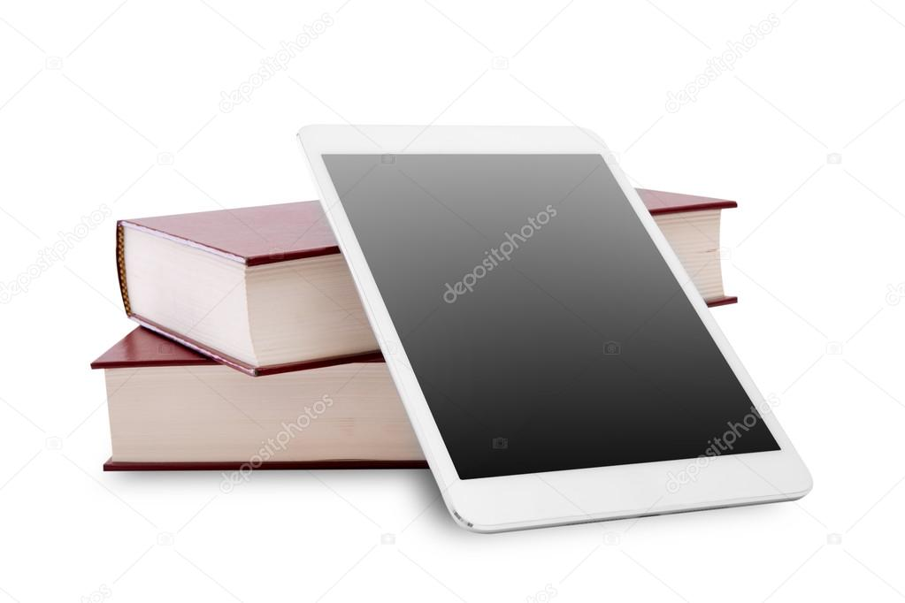 blank digital tablet and stack of books