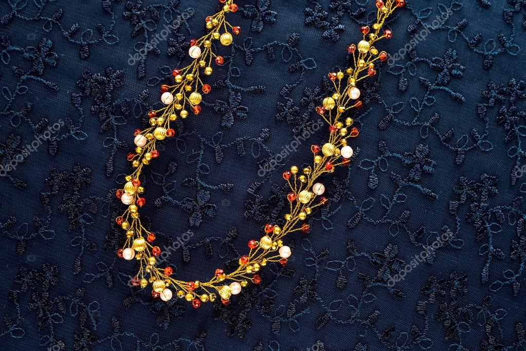 beautiful gold ornaments for the hair on a dark background. gold ...
