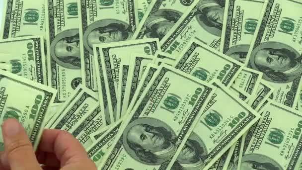 Podnikatelé, počítání peněz, sto dolarové bankovky