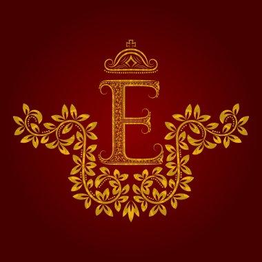Patterned golden letter E monogram in vintage style