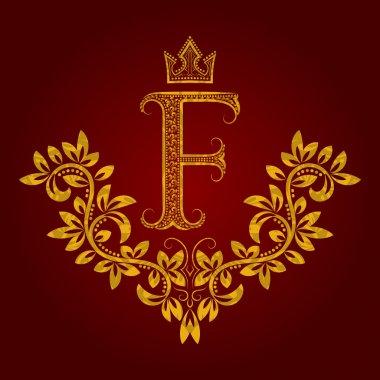Patterned golden letter F monogram in vintage style