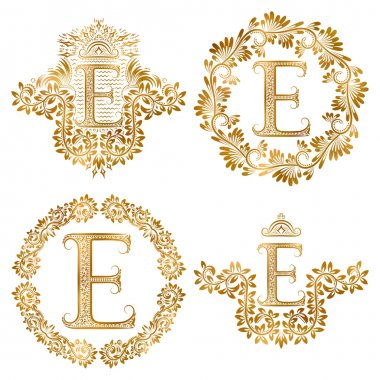 Golden letter E vintage monograms set. Heraldic monogram in coats of arms and round frames.