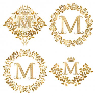 Golden letter M vintage monograms set.