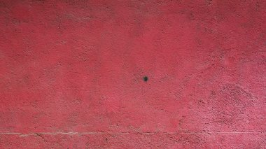 red weathered plaster wall background