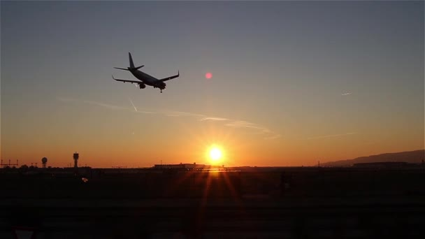 Plane landing at Barcelona Airport at dusk