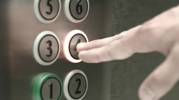 Man presses a button the fourth floor