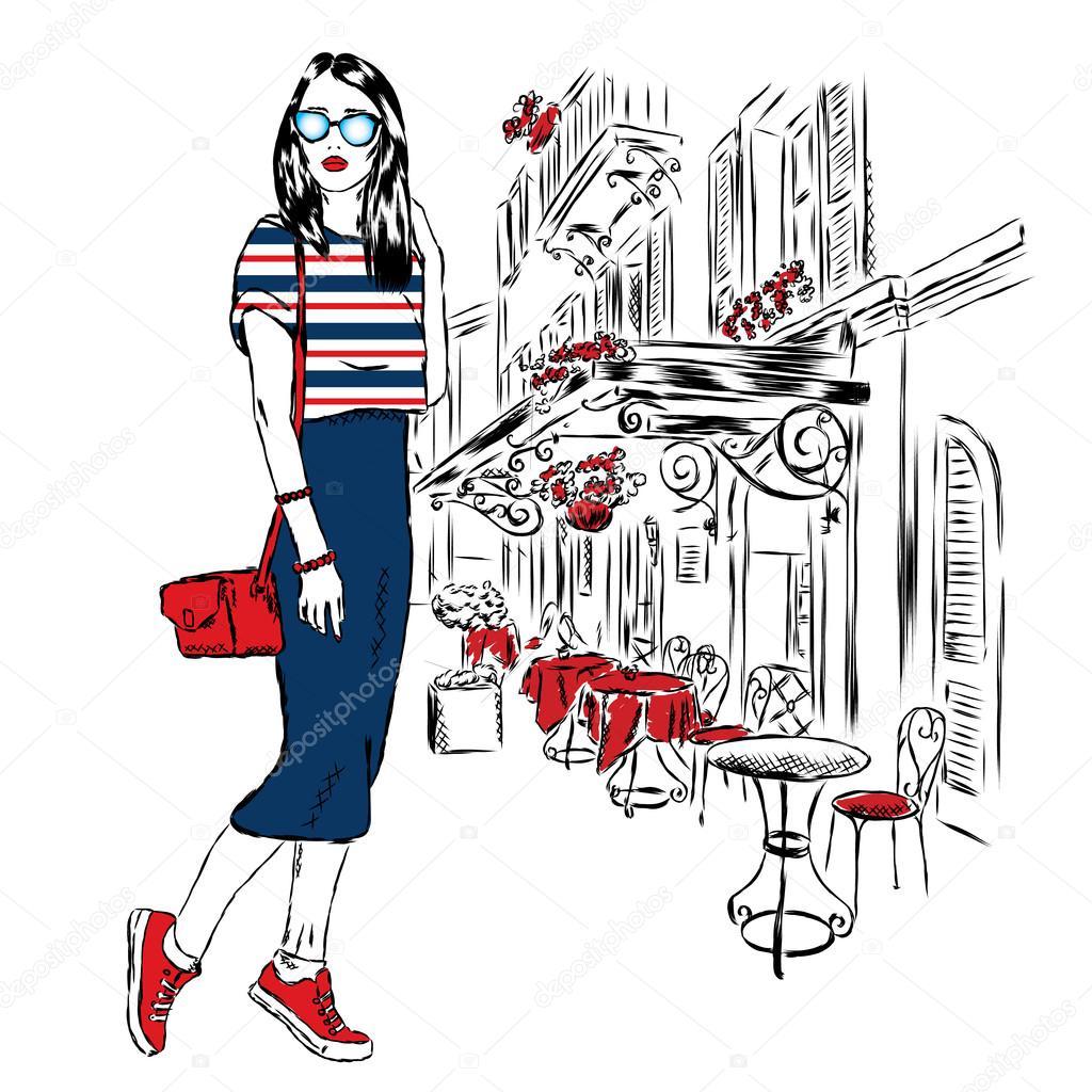 おしゃれな服を着て女の子都市の背景に通り。服にプリントやポスター