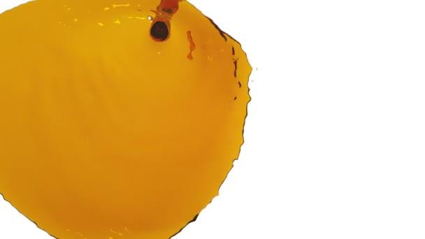 flow of orange liquid paint falls the screen. clear liquid
