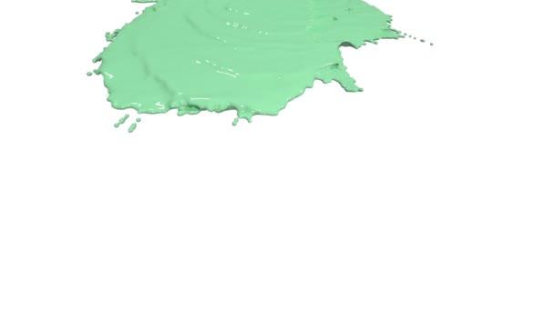 grüne Farbe, die sich in Zeitlupe auf Weiß ergießt. Farbe
