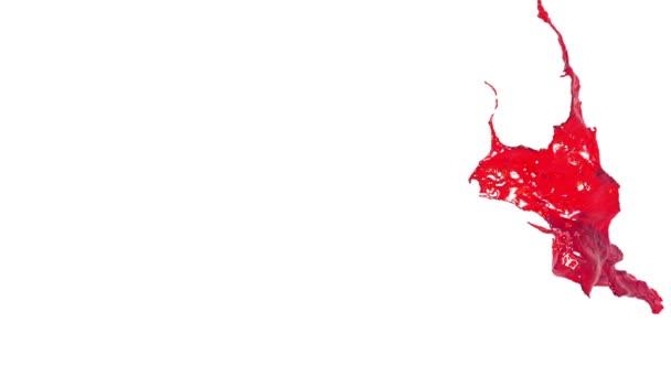 zblízka pohled na červenou šplouchání ve vzduchu. Šťávy