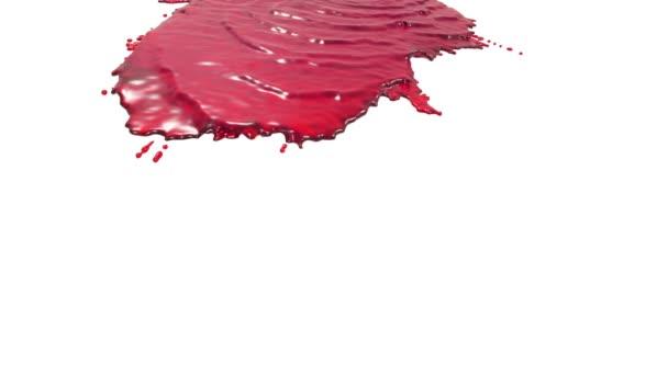rote Flüssigkeit auf weißem Hintergrund. Saft
