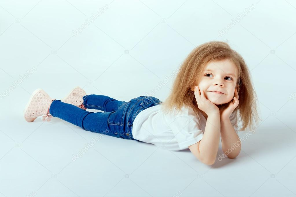 little girl 4 years old with curly hair wearing white