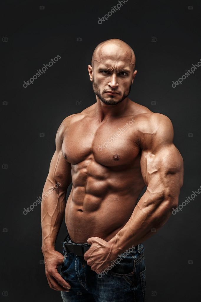Shirtless muscled fitness man  Cool looking  Tough guy  Bald