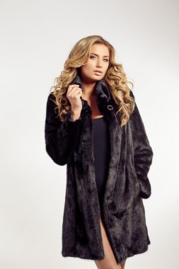 Portrait of a seductive lady in fur coat