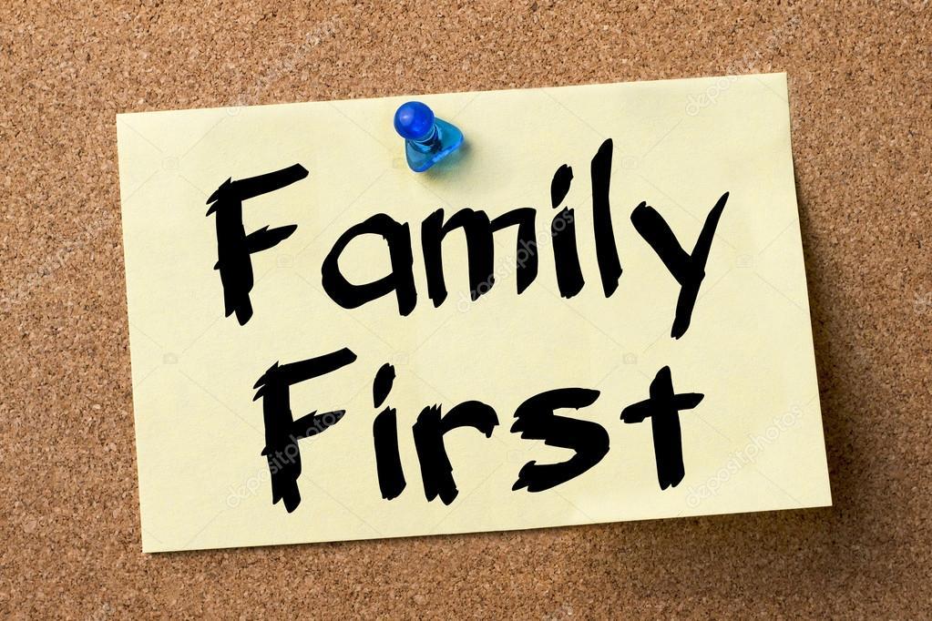 Family First - adhesive label pinned on bulletin board — Stock Photo ©  zsirosistvan #100239784