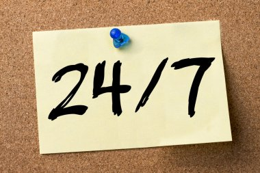 24/7 - adhesive label pinned on bulletin board