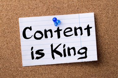Content is King - teared note paper pinned on bulletin board