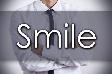 Smile - Young businessman with text - business concept