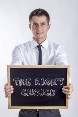 THE RIGHT CHOICE - Young businessman holding chalkboard