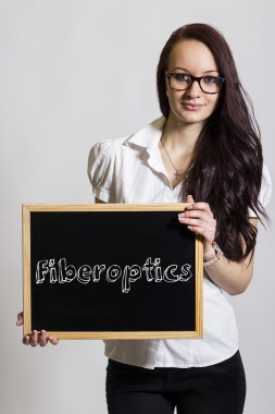 Fiberoptics - Young businesswoman holding chalkboard