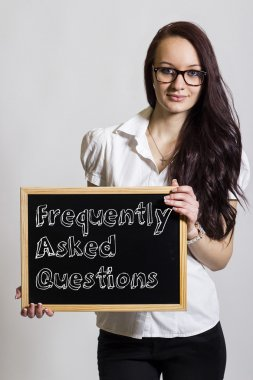 Frequently Asked Questions - Young businesswoman holding chalkbo