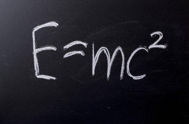E equals mc squared on chalkboard