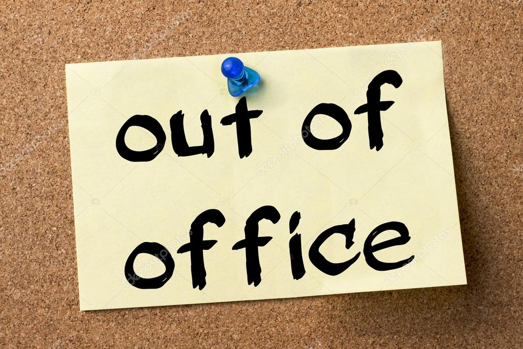 Out of office - adhesive label pinned on bulletin board ...