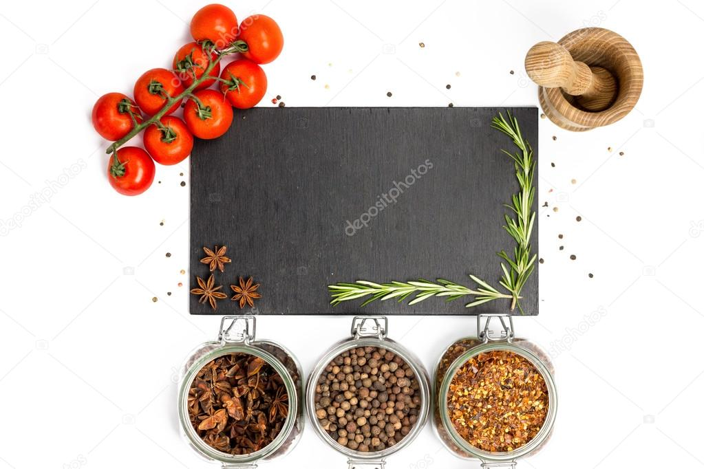 Spices and herbs in jars. Food, cuisine ingredients. Cherry branch.