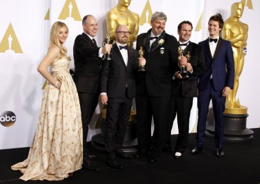 HOLLYWOOD, CA, USA - FEBRUARY 22, 2015: Chloe Grace Moretz, Paul Franklin, Andrew Lockley, Ian Hunter, Scott R. Fisher and Ansel Elgort at the 87th Annual Academy Awards - Press Room held at the Loews Hollywood Hotel in Hollywood.
