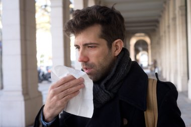 Man constipated with handkerchief