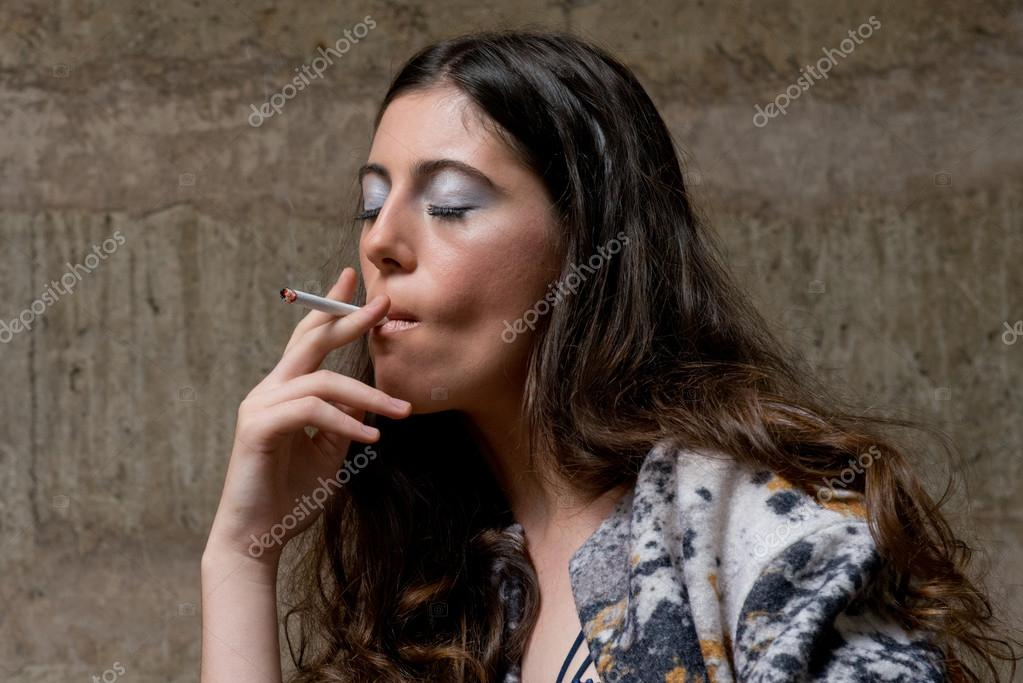 https://st2.depositphotos.com/5327424/9429/i/950/depositphotos_94299222-stock-photo-young-woman-smokes-cigarette-with.jpg