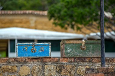 Someone left those two vintage suitcases right on top of a some stone wall at the colonial town of Villa de Leyva, in the Andean mountains of central Colombia.