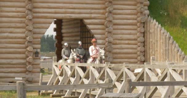 Wooden Gate Decorated With Forged Elements Are Open, Fortress Wall, Two Knights and Primce Vladimir the Great on a Horses are Riding By Bridge