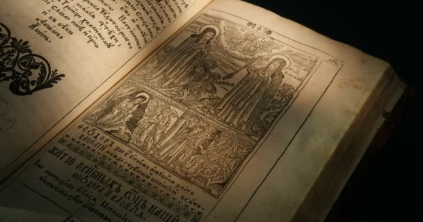 Old Book Paterik Of Kiev-Pecherska Lavra Old-Slavic Style of Writing Engravings Pictures Episodes from the Life of Saints Monks Turning Pages of Book