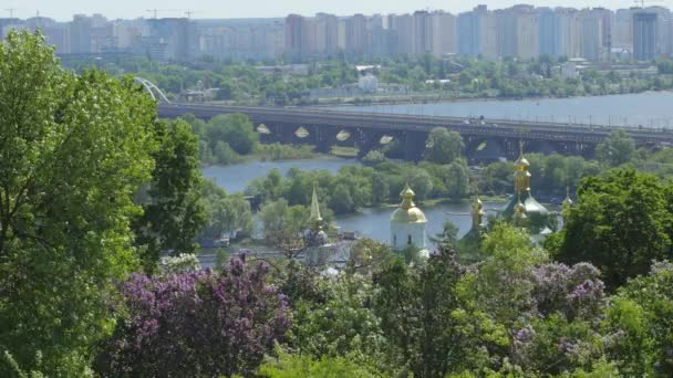 Multi-storey Houses On THe Left Bank Of The Dnieper Kiev Spring Landscape Domes Of Vydubychi Monastery White Clouds Railway Bridge Across The Dnieper
