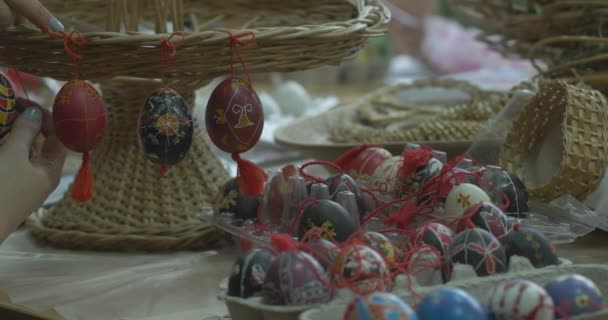 Woman Hangs Painted Easter Eggs On Wicker Stand Still Life Of Easter Eggs Girls Draw On Easter Eggs Technology Of Painting On Easter Egg