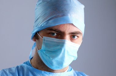 Surgeon in uniform close-up ready to step