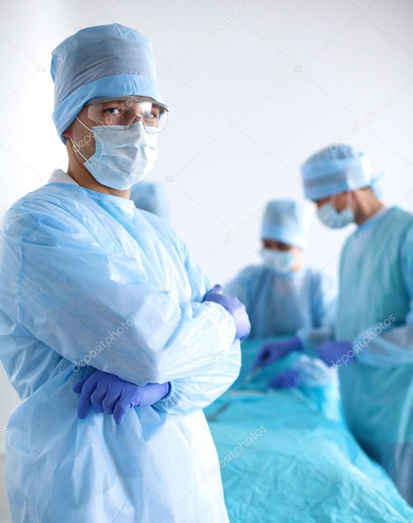 A team of surgeons at work in the operating room