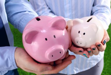 Piggy Bank in hands of a family