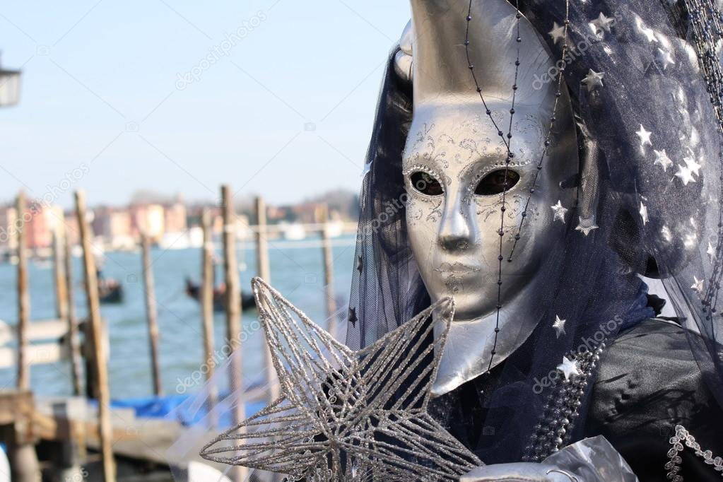 Venice, Italy - February 6, 2016: Unidentified persons with masks of