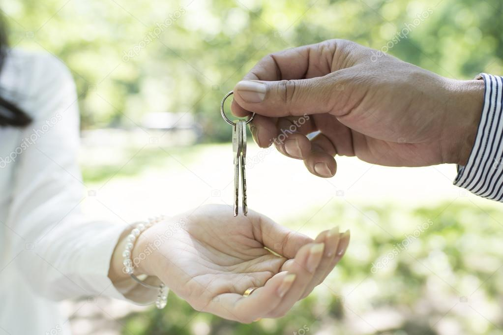 Man Hands Woman House Keys